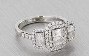 Platinum Three Stone Moissanite And Diamond Halo Ring - Portfolio